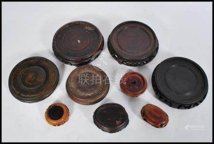A group of vintage Chinese hardwood vase stands dating from the 19th century of various forms and