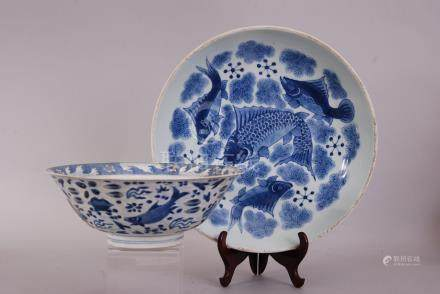 Large Chinese blue and white plate painted with four fish swimming amongst reeds and aquatic plants,