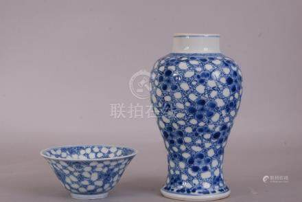 Chinese blue and white baluster vase, painted with prunus on a cracked-ice ground, Kangxi, 17cm
