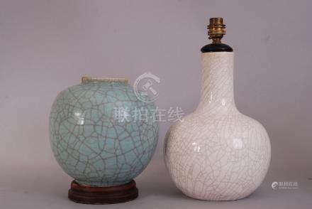 C19th Chinese pale green crackle-glazed jar, 21.5cm high, wood stand; together with a white