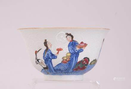 C19th Chinese famille rose sgraffito bowl, painted with figures in a riverside landscape scene,