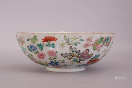 Chinese famille rose bowl, painted overall with butterflies and blossoming floral sprigs, Daoguang