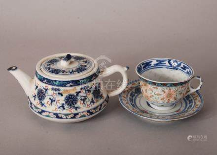 C19th Chinese iron-red and blue and white teapot and cover, painted with scrolling lotus, Qianlong