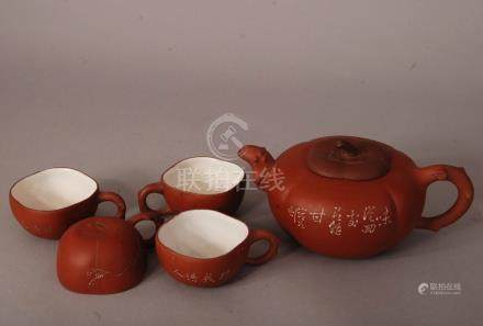C20th Chinese Zisha teapot and cover, of compressed and ribbed form, decorated with prunus and