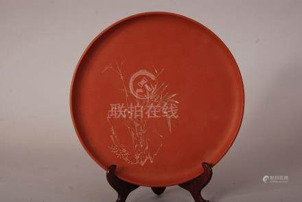C20th Chinese Zisha plate, incised with bamboo and rocks, 26cm diam.