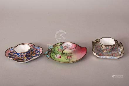 Three sets of C18th Chinese painted enamel cups and saucers, the first of peach form and painted