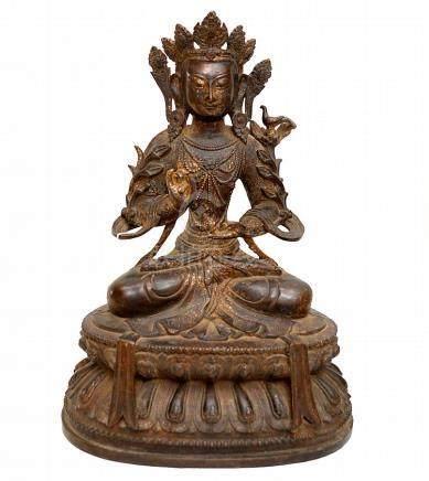 EARLY CHINESE BRONZE SEATED BUDDHA. The bronze still retaini