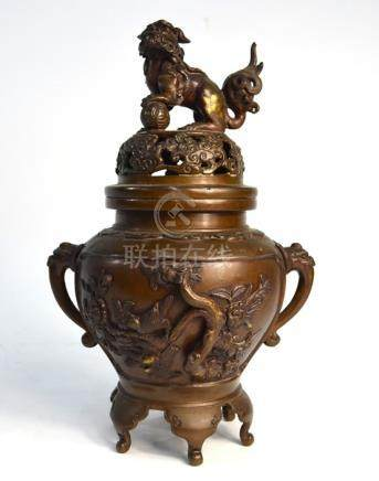 A Japanese bronze koro with pierced, domed cover and karashishi finial; decorated in takabori with