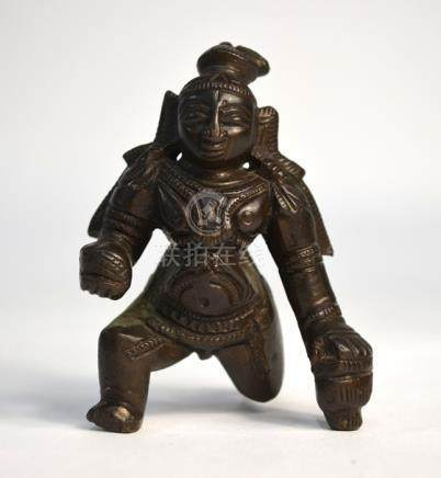 A small, Indian bronze figure of the young Krishna, holding the butterball with his right hand, 9 cm
