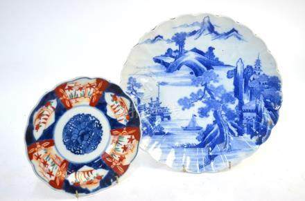 A Japanese sometsuke dish of kikugata form, decorated with a pagoda building in a mountainous