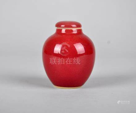 Chinese ox blood porcelain jar with lid.