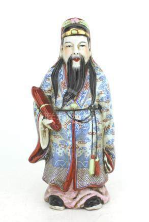 A CHINESE PORCELAIN IMMORAL FIGURINE