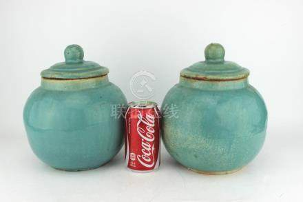 PAIR OF CHINESE GREEN GLAZED CELADON LIDDED JARS