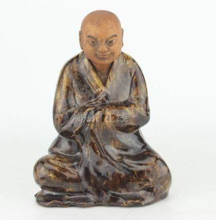 A CHINESE PORCELAIN BUDDHA FIGURINE
