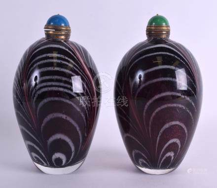 A LARGE PAIR OF CHINESE ART GLASS SCENT BOTTLE AND STOPPERS with swirling design. 19 cm x 8 cm.