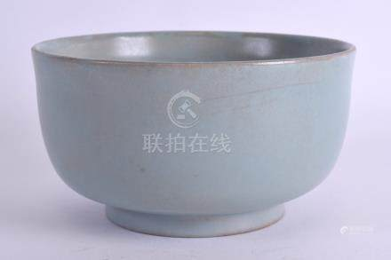 A CHINESE PALE BLUE GLAZED PORCELAIN BOWL 20th Century, Sung style, with faint mushroom lip. 14 cm