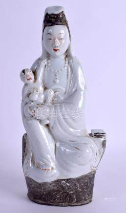 AN EARLY 20TH CENTURY CHINESE PORCELAIN FIGURE OF GUANYIN modelled holding a child. 28 cm high.
