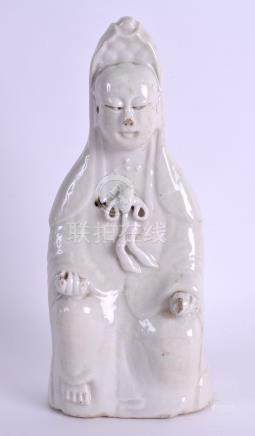 AN EARLY 18TH CENTURY CHINESE BLANC DE CHINE FIGURE OF GUANYIN Qing, modelled holding a scroll. 22