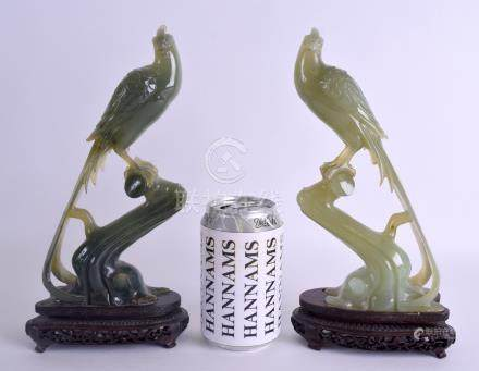 A LARGE PAIR OF 19TH CENTURY CHINESE CARVED JADE FIGURES OF BIRDS modelled upon naturalistic