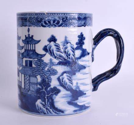 A LARGE 18TH CENTURY CHINESE EXPORT BLUE AND WHITE MUG Qianlong, painted with landscapes. 15 cm