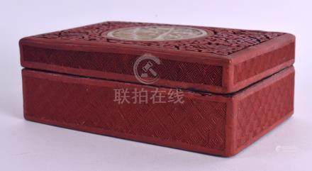 A 19TH CENTURY CHINESE CARVED CINNABAR LACQUER BOX AND COVER inset with a jade foliate roundel. 15
