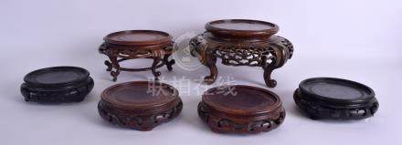 A LARGE 19TH CENTURY CHINESE CARVED HARDWOOD STAND together with five others. Largest 17 cm wide. (