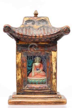 GAU TRAVEL SHRINEWood painted with Clay BuddhaMongolia, 19th centuryH: 15 cm / W: 10 cm / D: 6,5 cm