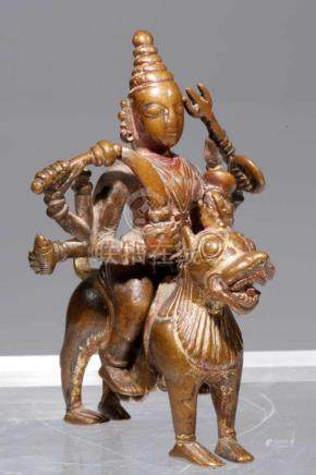 DURGAbronze,Nepal, 16th century,H: 10 cmIt is eight armed Dura sitting astride her vahana, lion. A
