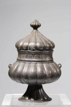 SILVER VESSELhammered silver,India, 18th centuryH: 23 cmLotusflower shapped offering vessel, in