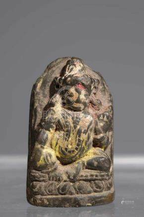 KHASARPANA LOKESHVARAstone with rest pujas,Nepal, 17th centuryH: 5 cmSitting with a leg pendant, the