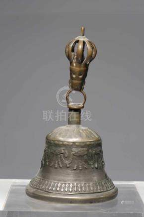 GHANTAbronze bell with copper handle,Tibet, 16th centuryH: 17 cmHandle is surmounted with half