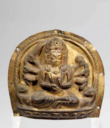 BHAIRABAcopper repousse, fire gilt Nepal, 17th centuryH: 18 cmRare form of a Sitting Bhairaba. Two