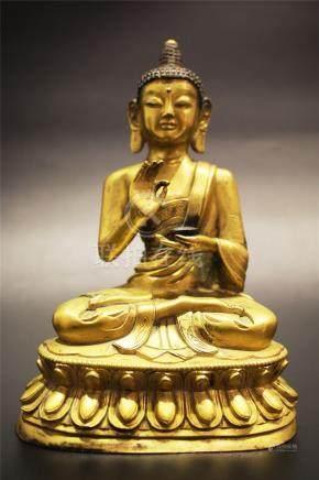 A Gilt-Bronze Figure Of The Medicine Buddha