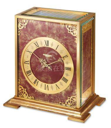 """Patek Philippe, A Gilt Brass Solar Panel """"Burgandy"""" Clock, Ref. 809 Mvt No 873.539 Case No 1.098, Made in 1964 with Patek Philippe Extract from the Archives"""