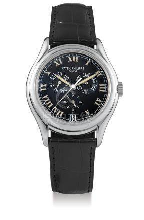Patek Philippe, A White Gold Automatic Center Seconds Annual Calendar Wristwatch, Ref. 5035G, with certificate