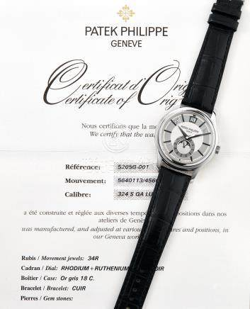 Patek Philippe, A Fine White Gold Annual Calendar, Centre Seconds Automatic Wristwatch with Moonphases