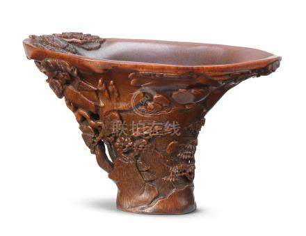 A rare rhinoceros horn 'landscape' libation cup 17th century (2)
