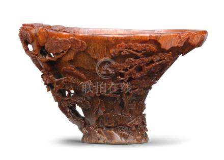 A rare rhinoceros horn 'riverscape' libation cup 17th century (2)
