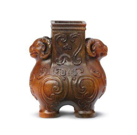 A very rare and exquisite archaistic rhinoceros horn 'double-ram' vessel, zun Signed Bao Tiancheng, 17th century (4)