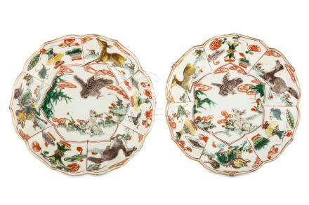 A PAIR OF CHINESE FAMILLE VERTE FOLIATE RIM 'RABBIT AND HAWK' SAUCER DISHES. Kangxi. Each