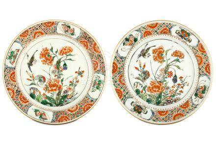 A PAIR OF CHINESE FAMILLE VERTE 'BIRD AND FLOWER' DISHES. Kangxi. The central roundel finely