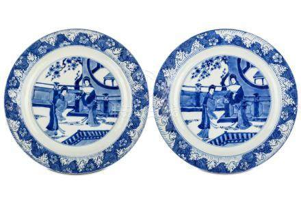 A PAIR OF CHINESE BLUE AND WHITE 'LADIES' DISHES. Kangxi. Each with a central roundel enclosing