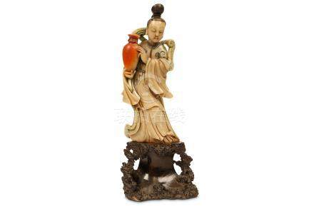 A CHINESE SOAPSTONE CARVING OF A LADY. Kangxi. Standing in long flowing robes with trailing ribbons