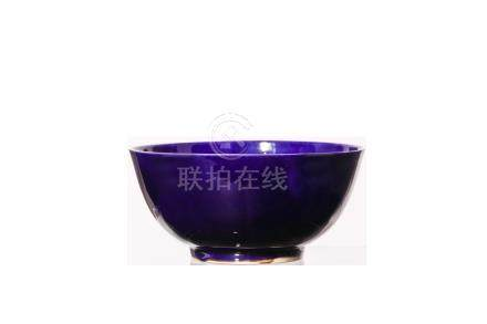A CHINESE AUBERGINE-GLAZED DEEP BOWL. Kangxi mark and of the period. With steeply rounded deep sides