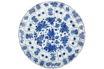 A CHINESE BLUE AND WHITE 'PEONIES' MOULDED DISH. Kangxi mark and of the period. Decorated with a