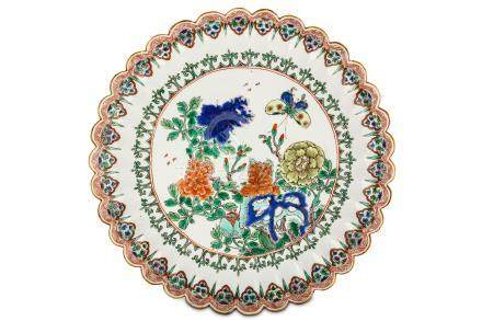 A CHINESE FAMILLE VERTE 'FLOWER AND BUTTERFLY' MOULDED DISH. Kangxi. Brightly enamelled in green,