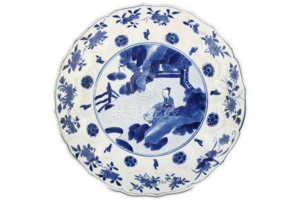 A CHINESE BLUE AND WHITE 'SCHOLAR' DISH. Kangxi mark and of the period. The central roundel painted