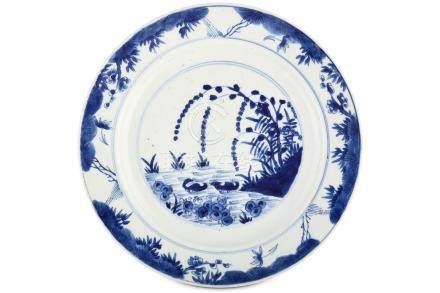 A CHINESE BLUE AND WHITE 'MANDARIN DUCKS' DISH. Kangxi mark and of the period. Painted with a