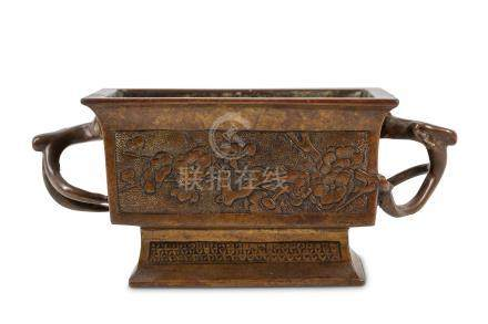 A CHINESE BRONZE 'PRUNUS' INCENSE BURNER. Kangxi. The rectangular censer supported on a flared
