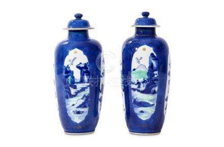 A PAIR OF CHINESE POWDER BLUE JARS AND COVERS. Kangxi. Decorated with quatrefoil panels alternately